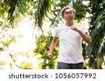 senior asian man jogging in a...   Shutterstock . vector #1056057992