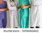 doctors and nurses are crossing ... | Shutterstock . vector #1056063662