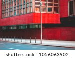 office brick building in a lone ...   Shutterstock . vector #1056063902