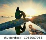 young traveler man at... | Shutterstock . vector #1056067055