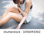 a beautiful woman gets hurt ... | Shutterstock . vector #1056093302