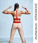 muscular back of woman flexing... | Shutterstock . vector #1056106142