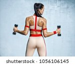 athletic woman doing exercise...   Shutterstock . vector #1056106145