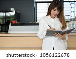 small business owner holding... | Shutterstock . vector #1056122678
