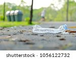 a plastic bottle of drinking... | Shutterstock . vector #1056122732