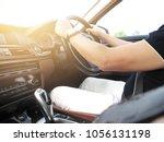 man driving car hand on...   Shutterstock . vector #1056131198