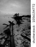 An Abandon Shipwreck In Black...