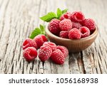 raspberry on wooden board | Shutterstock . vector #1056168938