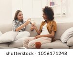 friends toasting with... | Shutterstock . vector #1056171248