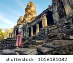 woman tourist in front of bayon ...   Shutterstock . vector #1056181082