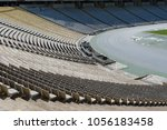 empty stadium seats row in a... | Shutterstock . vector #1056183458