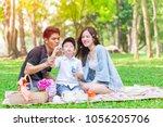 asian teen family happy holiday ...   Shutterstock . vector #1056205706