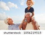 Grandparents Carrying Grandson...
