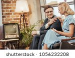 happy 50s style couple sitting... | Shutterstock . vector #1056232208