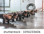 group of sportsmen and... | Shutterstock . vector #1056233606