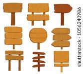 empty cartoon wooden signs. old ... | Shutterstock .eps vector #1056240986