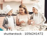 children in chef's hats with... | Shutterstock . vector #1056241472