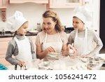 children in chef's hats with... | Shutterstock . vector #1056241472
