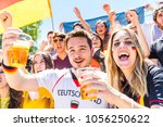 german supporters celebrating... | Shutterstock . vector #1056250622