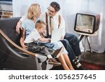 happy 50s style family with one ... | Shutterstock . vector #1056257645