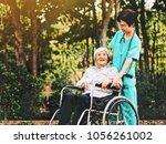 senior nurse take care elderly...   Shutterstock . vector #1056261002