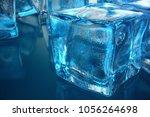3d rendering ice cube on blue... | Shutterstock . vector #1056264698