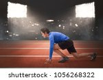 handsome asian runner man in... | Shutterstock . vector #1056268322