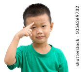 happy asian child pointing his... | Shutterstock . vector #1056269732