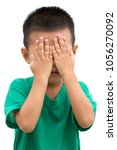 asian child covered eyes with... | Shutterstock . vector #1056270092