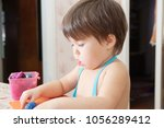 little girl playing with... | Shutterstock . vector #1056289412