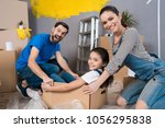 home repair. moving young... | Shutterstock . vector #1056295838