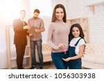beautiful mother with her... | Shutterstock . vector #1056303938