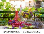 raspberries on a table with... | Shutterstock . vector #1056339152