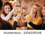 girlfriends drinking wine and... | Shutterstock . vector #1056339248