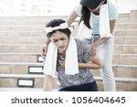 sport women is clutching her... | Shutterstock . vector #1056404645