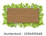 empty wooden sign with space... | Shutterstock .eps vector #1056405668