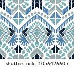 ikat geometric folklore... | Shutterstock .eps vector #1056426605
