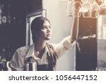 female bartender shaking... | Shutterstock . vector #1056447152