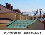 houses with new roofs  roofing... | Shutterstock . vector #1056503315