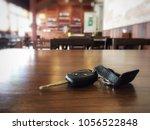 loss car key on brown wood... | Shutterstock . vector #1056522848