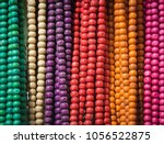 hanging colourful wooden beads... | Shutterstock . vector #1056522875