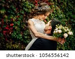 happy young bride and groom on... | Shutterstock . vector #1056556142