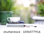 white cup and notebooks with... | Shutterstock . vector #1056577916