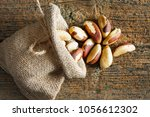 brazil nuts in small sack on... | Shutterstock . vector #1056612302