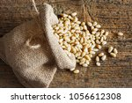 pine nuts in small sack on... | Shutterstock . vector #1056612308