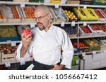 avery hungry man against the...   Shutterstock . vector #1056667412