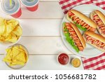 hot dogs on wooden background | Shutterstock . vector #1056681782