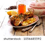 roast whole leg of veal with... | Shutterstock . vector #1056685592