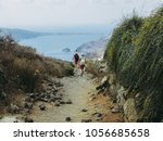 two young women  tourists hike... | Shutterstock . vector #1056685658