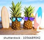 couple of attractive pineapples ... | Shutterstock . vector #1056689042